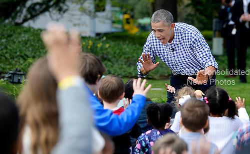 President Barack Obama (C) high fives with young participants during the White House Easter Egg Roll on the South Lawn of the White House March 28, 2015 in Washington, DC. Photo by Olivier Douliery/Sipa USA