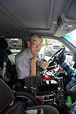 KAZ / Kasachstan / Pavlodar / 25.07.213 / Der querschnittgelähmte Georgij Tschetverikov in seinem Rollstuhl am Steuer seines behindertengerecht umgebauten Mercedes Vito. Chetverikov ist nach einem Badeunfall querschnittsgelähmt / 61 years old tetraplegic Georgy Chetverikov in his electric wheelchair sitting in his wheelchair accessible vehicle. He is handicapped after a swimming accident at the age of 18.