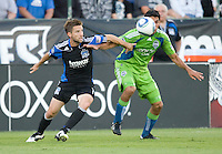 Bobby Convey of Earthquakes fights for the ball against Leo Gonzalez of Sounders during the game at Buck Shaw Stadium in Santa Clara, California on July 31st, 2010.   Seattle Sounders defeated San Jose Earthquakes, 1-0.