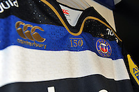 A close up view of the Bath Rugby emblem on a matchday jersey. Bath Rugby Family Festival of Rugby, on August 8, 2015 at the Recreation Ground in Bath, England. Photo by: Patrick Khachfe / Onside Images