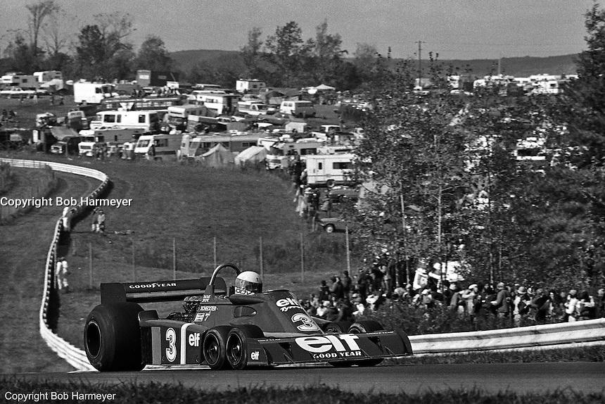 Jody Scheckter drives the Tyrrell P34 six-wheel Formula 1 car during the 1976 United States Grand Prix at Watkins Glen.