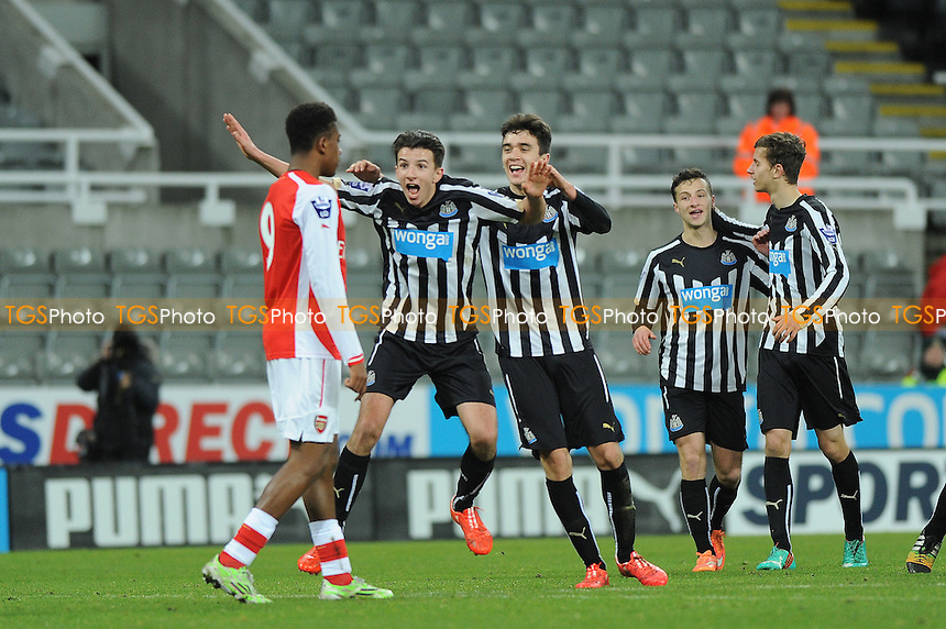 Dan Barlaser of Newcastle United celebrates scoring the equaliser in front of Arsenal goalscorer Alex Inobi - Newcastle United Under-21 vs Arsenal Under-21 - Barclays Under-21 Premier League Football at St James Park, Newcastle United FC - 09/02/15 - MANDATORY CREDIT: Steven White/TGSPHOTO - Self billing applies where appropriate - contact@tgsphoto.co.uk - NO UNPAID USE