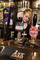 Samantha Adams pours the perfect pint at The Fountain Bridge carvery restaurant and pub at Kirkby in Ashfield, Nottinghamshire.