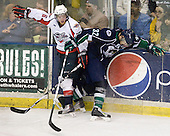 Ryan Ellis (Windsor - 6), Michal Jordan (Plymouth - 32) - The Windsor Spitfires defeated the Plymouth Whalers 3-2 (OT) to sweep the Ontario Hockey League Western Conference Semi-Finals on Wednesday, April 7, 2010, at Compuware Arena in Plymouth, Michigan.