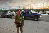 Lori stands outside the Fairbanks International Airport a few minutes after our plane landed. Even though it was 12:27 AM, the sun has yet to set.