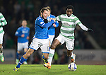 St Johnstone v Celtic.....26.12.13   SPFL<br /> Stevie May gets a sore one from Efe Ambrose<br /> Picture by Graeme Hart.<br /> Copyright Perthshire Picture Agency<br /> Tel: 01738 623350  Mobile: 07990 594431