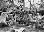 Manhattan, New York City, NY. April, 1975.<br /> Hippies hanging out in Washington Square Park (Greenwhich Village) on a Sunday's afternoon. It is common for young americans to gather in the park and drink lots of alcohol, and smoke marijuana.
