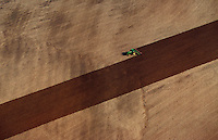 Aerial agricultural landscape of a farmer plowing a field for planting in spring. Arkansas.