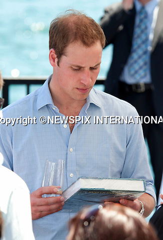 """PRINCE WILLIAM.Gets Water Warriors as a gift.Prince William attended a BBQ lunch with Christina Keneally (Premier of New South Wales). The BBQ was held at Mrs Macquaries Chair, Sydney with the beautiful backdrop of Sydney Harbour Bridge and the Sydney Opera House.William met a host of Sydney residents recived some gift, posed for a photo op with Christina Keneally and took a private boat ride on a RIB around the Harbour. Mrs Macquaries Chair, Sydney, Australia_20/01/2010..Mandatory Credit Photo: ©DIAS-NEWSPIX INTERNATIONAL..**ALL FEES PAYABLE TO: """"NEWSPIX INTERNATIONAL""""**..IMMEDIATE CONFIRMATION OF USAGE REQUIRED:.Newspix International, 31 Chinnery Hill, Bishop's Stortford, ENGLAND CM23 3PS.Tel:+441279 324672  ; Fax: +441279656877.Mobile:  07775681153.e-mail: info@newspixinternational.co.uk"""