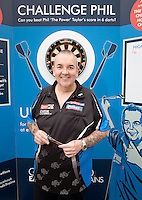 Phil 'The Power' Taylor raised money for The Children's Hospital Charity by challenging the public at darts at Sheffield Train Station
