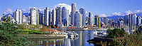 "City of Vancouver Skyline and Downtown at Yaletown and ""False Creek"", British Columbia, Canada, in Autumn / Fall.  Granville Island is in the left foreground, and the North Shore Mountains (Coast Mountains) rise above the City. - Panoramic View"
