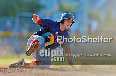 30 June 2012: Lowell Spinners infielder Nathan Minnich slides home safely during a game against the Vermont Lake Monsters at Centennial Field in Burlington, Vermont. Mandatory Credit: Ed Wolfstein Photo