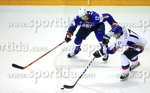 Lubomir Visnovsky of Slovakia and David Rodman of Slovenia at ice-hockey game Slovenia vs Slovakia at second game in  Relegation  Round (group G) of IIHF WC 2008 in Halifax, on May 10, 2008 in Metro Center, Halifax, Nova Scotia, Canada. Slovakia won after penalty shots 4:3.  (Photo by Vid Ponikvar / Sportal Images)