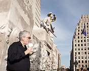 April 4, 2010. Indianapolis, Indiana.. A tourist sips a drink while visiting the Soldiers and Sailors Monument in Indianpolis, Indiana.