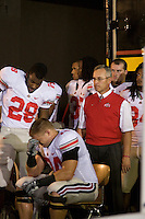 06 October 2007: Ohio State head coach Jim Tressel..The Ohio State Buckeyes defeated the Purdue Boilermakers 23-7 at Ross-Ade Stadium, West Lafayette, Indiana.  Just before game time Ohio State Head Coach Jim Tressel looks on as an emotional Kirk Barton (hands covering face) is consoled by Chris Wells (28).