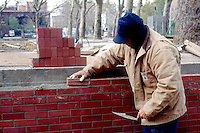 BRICK WALL UNDER CONSTRUCTION<br /> Wall is made of individual repeating units stacked together in a regular way.
