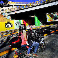 Bogotá motorcyclists drive along a large mural artwork, created on the highway retaining walls, in the center of Bogotá, Colombia, 14 February, 2016. A social environment full of violence and inequality (making the street art an authentic form of expression), with a surprisingly liberal approach to the street art from Bogotá authorities, have given a rise to one of the most exciting and unique urban art scenes in the world. While it's technically not illegal to scrawl on Bogotá's walls, artists may take their time and paint in broad daylight, covering the walls of Bogotá not only in territory tags and primitive scrawls but in large, elaborate artworks with strong artistic style and concept. Bogotá has become an open-air gallery of contemporary street art.