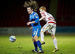 St Johnstone v Hamilton Accies....02.02.11  .Stevie May fends off Ziggy Gordon.Picture by Graeme Hart..Copyright Perthshire Picture Agency.Tel: 01738 623350  Mobile: 07990 594431