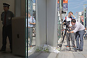 October 6, 2011: Tokyo, Japan - Foreign media shoot the flowers left for the late Steve Jobs, founder and former CEO of Apple Inc., outside the Apple store in the Ginza shopping district of Tokyo. Jobs passed away in the United States at the age of 56 after a long battle with cancer. (Photo by Christopher Jue/AFLO)