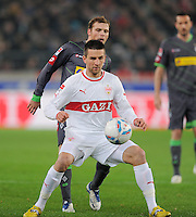 FUSSBALL   1. BUNDESLIGA  SAISON 2011/2012   19. Spieltag   29.01.2012 VfB Stuttgart - Borussia Moenchengladbach    Vedad Ibisevic (vorn, VfB Stuttgart) gegen Tony Jantschke (Borussia Moenchengladbach)