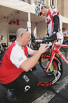 November 12 2011 - Guadalajara, Mexico:   Eric Bourgault has his bicycle examined by Head Mechanic Patrick Gautier at the 2011 Parapan American Games.  Photos: Matthew Murnaghan/Canadian Paralympic Committee