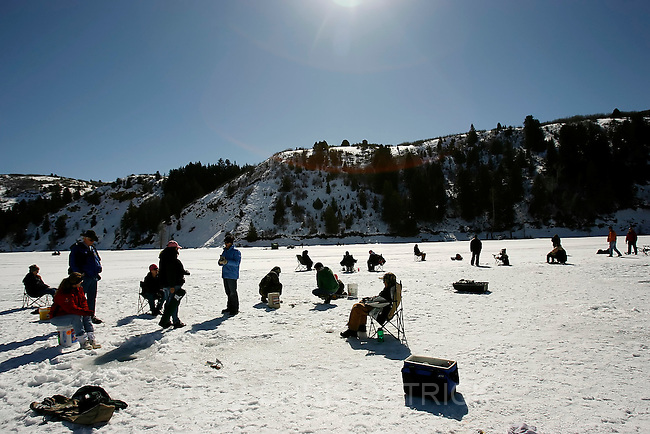 Salt Lake City,UT--2/25/06--12:09:36 PM-.About 20 women participated in the ice fishing clinic where the instructors  set each student up with ice-fishing rods and bait. They also gave personal instruction on how to bait the line, jig for fish and reel in the fish they caught...The Becoming an Outdoors Women (BOW) is holding an ice fishing clinic Saturday starting at 9 a.m. at the Rock Cliff Arm of Jordanelle Reservoir (Directions below). As of Monday, they had 23 women signed up to participate in the clinic presented by Mickey Anderson of Fish Tech Outfitters..Chris Detrick/Salt Lake Tribune.File #_1CD7625
