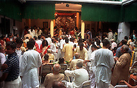 INDIA (West Bengal - Calcutta)  2006,Gathering of family members and friends at Mullick family (one of the well known families in South Calcutta) on the occassion of Durga Puja Festival. Durga Puja Festival is the biggest festival among bengalies.  As Calcutta is the capital of West Bengal and cultural hub of  the bengali community Durga puja is held with the maximum pomp and vigour. Ritualistic worship, food, drink, new clothes, visiting friends and relatives places and merryment is a part of it. In this festival the hindus worship a ten handed godess riding on a lion armed wth all possible deadly ancient weapons along with her 4 children (Ganesha - God for sucess, Saraswati - Goddess for arts and education, Laxmi - Goddess of wealth and prosperity, Kartikeya - The god of manly hood and beauty). Durga is symbolised as the women power in Indian Mythology.  In Calcutta people from all the religions enjoy these four days of festival in the moth of October. Now the religious festival has become the biggest cultural extravagenza of Calcutta the cultural capital of India. Artistry and craftsmanship can be seen in different sizes and shapes in form of the idol, the interior decor and as well as the pandals erected on the streets, roads and  parks.- Arindam Mukherjee