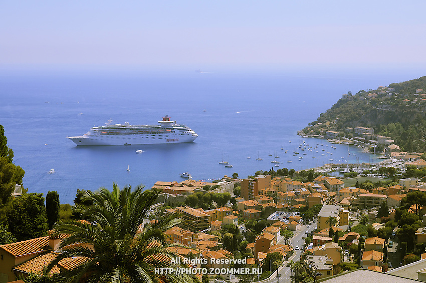 """Big and luxury cruising ship """"Pullmantur"""" in French riviera between Saint Tropez and Monaco."""