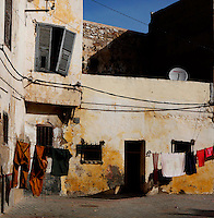 """Clothes hanging on string in front of old houses, Portuguese Fortified city of Mazagan, El Jadida, Morocco. El Jadida, previously known as Mazagan (Portuguese: Mazag""""o), was seized in 1502 by the Portuguese, and they controlled this city until 1769. Picture by Manuel Cohen"""