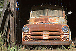 Digital art of a rusty old dodge pickup in a old barn, created from a original photograph
