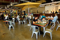 Interior photography of the 7th Street Public Market in Uptown Charlotte, North Carolina. Building upon the success of Charlotte's Center City Green Market, the Seventh Street Public Market opened in 2012 to be a year-round market serving and celebrating local food artisans, entrepreneurs and local and regional farmers. Image is part of a series of photos taken of the Center City attraction.