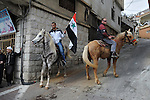 Druze men ride horses during a rally supporting Syrian president Assad in Majdal Shams, Golan Heights.