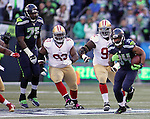 Seattle Seahawks running back Thomas Rawls (34) cuts the corner and runs away from San Francisco 49ers defenders at CenturyLink Field in Seattle, Washington on November 22, 2015.  The Seahawks beat the 49ers 29-13.   ©2015. Jim Bryant Photo. All RIghts Reserved.