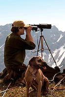 Liechtenstein  Malbun  June 2008.Small town high in the Alpine (southeastern)..Fürstin-Gina-Weg' (Princess Gina memorial trail). Men observe some animals in the background Austrian Alps..