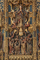 Detail of the Assumption of the Virgin from the main altarpiece in the main chapel, in the Old Cathedral of Coimbra, or Se Velha de Coimbra, a 12th century Romanesque Roman Catholic cathedral in Coimbra, Portugal. The altarpiece, 1503, is of gilded and polychrome wood in Gothic style, was commissioned by Bishop Jorge de Almeida and made by the Flemish masters Olivier de Gante and Jean d'Ypres. The cathedral was designed by Master Robert, a French architect, with the works overseen by Master Bernard and Master Soeiro. It was reworked in the 16th century, with the addition of tiled decoration, a portal and Renaissance chapel. The city of Coimbra dates back to Roman times and was the capital of Portugal from 1131 to 1255. Its historic buildings are listed as a UNESCO World Heritage Site. Picture by Manuel Cohen