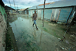 A boy walks through a flooded street in Batey Bombita, a community in the southwest of the Dominican Republic whose population is composed of Haitian immigrants and their descendents.