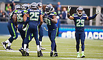 Seattle Seahawks defensive back field  celebrates an interception by cornerback Byron Maxwell against the St. Louis Rams at CenturyLink Field in Seattle, Washington on December 29, 2013.  Seahawks clinched the NFC West title and home-field advantage throughout the playoffs with a 27-9 victory over the St. Louis Rams.  ©2013. Jim Bryant Photo. ALL RIGHTS RESERVED.