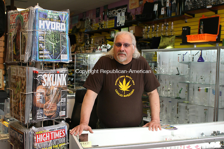 WATERBURY, CT, 07 April, 2016 - 040716LW02 - John Carusello stands next to copies of marijuana magazines at his Lifestyles shop on Lakewood Road in Waterbury. <br /> Laraine Weschler Republican-American