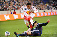 oDane Richards (19) of the New York Red Bulls is defended by Chris Tierney (8) of the New England Revolution. The New York Red Bulls defeated the New England Revolution 2-0 during a Major League Soccer (MLS) match at Red Bull Arena in Harrison, NJ, on October 21, 2010.