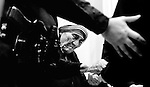 Mother Teresa gives out medals to grateful parishioners while under police protection after speaking to a packed cathedral in which sister's from her order were recognized.