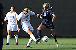 06 September 2013: Duke's Kim DeCesare (19) and West Virginia's Kara Blosser (32). The Duke University Blue Devils hosted the West Virginia University Mountaineers at Koskinen Stadium in Durham, NC in a 2013 NCAA Division I Women's Soccer match. The game ended in a 1-1 tie after two overtimes.