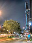 Bitexco Financial Centre across Bridge on Nguyen Tat Thanh, Ho Chi Minh City, Vietnam; Traffic