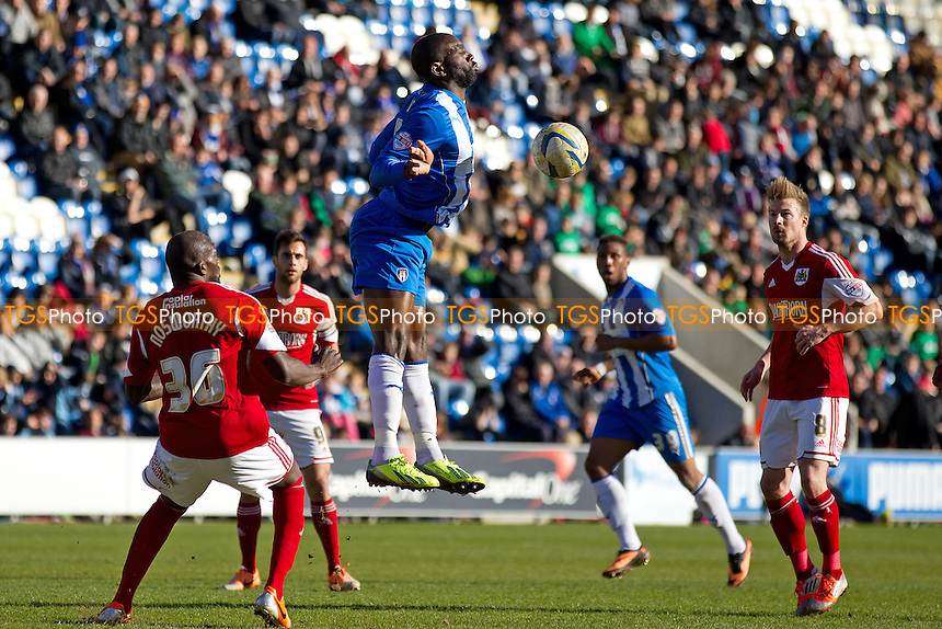 Jabo Ibehre of Colchester United tries to chest the ball into the path of an oncoming Colchester team mate - Colchester United v Bristol City - Sky Bet Championship League Football Division 1 at the Weston Homes Community Stadium, Ipswich, Colchester, Essex  - 22/03/14 - MANDATORY CREDIT: Ray Lawrence/TGSPHOTO - Self billing applies where appropriate - 0845 094 6026 - contact@tgsphoto.co.uk - NO UNPAID USE