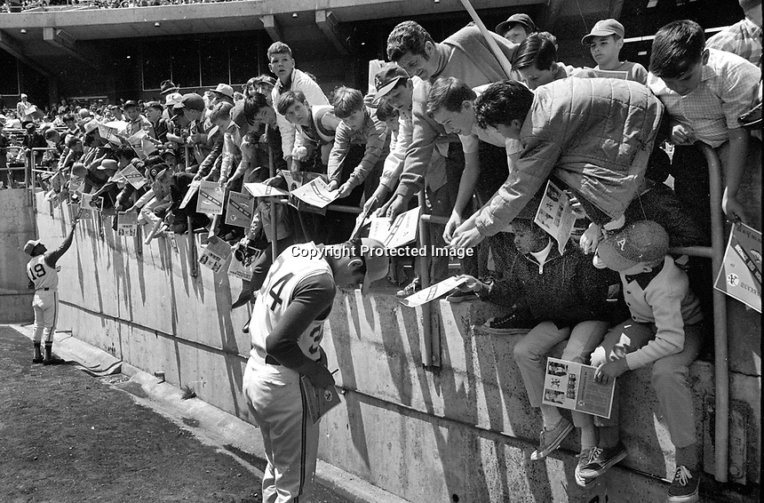 Oakland Athletics Campy Campaneris and Rollie Fingers sign autographs before A's game (1969 photo/Ron Riesterer)