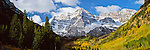 Capped with snow in late September, the Maroon Bells of Colorado stand above a glacial valley--already in the midst of an atuumn transformation as the aspen trees change to a golden yellow.<br />