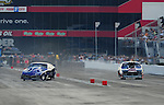 Jun. 18, 2011; Bristol, TN, USA: NHRA pro mod driver Roger Burgess (left) loses control prior to crashing alongside Kenny Lang after winning round one during eliminations at the Thunder Valley Nationals at Bristol Dragway. Mandatory Credit: Mark J. Rebilas-