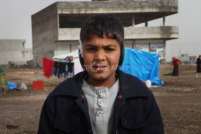 ARBAT, IRAQ: Murad Aqil, 9, from Derzor, Syria, is pictured in a refugee camp in Arbat, Iraq. ..The semi-autonomous region of Iraqi Kurdistan has accepted refugees from the conflict in Syria into several camps. Arbat lies near Sulaimaniyah in northeastern Iraq, approximately 500 kilometres from the Syrian border...Photo by Besaran Tofiq/Metrography