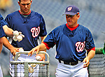 24 May 2009: Washington Nationals' hitting coach Rick Eckstein returns baseballs to the basket prior to a game against the Baltimore Orioles at Nationals Park in Washington, DC. The Nationals rallied to defeat the Orioles 8-5 and salvage a win in their interleague series. Mandatory Credit: Ed Wolfstein Photo