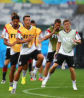 Mesut Ozil of Germany and his team mates in action during training ahead of tomorrow's semi final vs Brazil
