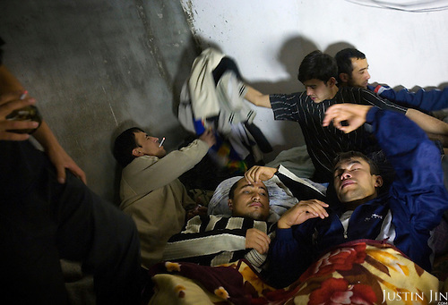 Migrant workers from Uzbekistan sleep on the floor in a cellar in central Moscow, Russia. Eleven of them share the floor space.